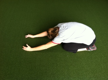 One of my favorite recovery moves....child's pose with attention on the lat stretch!
