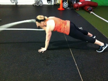 If you are looking for a serious core move, try a plank with one arm waves!