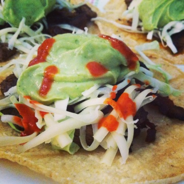 bacon ribeye tacos with avocado salsa